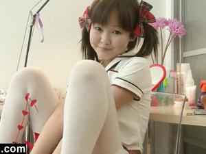 Cute Asian schoolgirl dresses up and masturbates