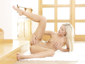 Blonde Dido Angel fingers pussy and eats cum