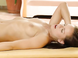 Brunette babe tenderly touches clean shaved cunt