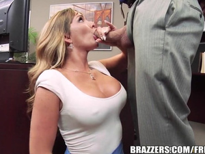 Blonde milf is sitting on her knees and being fucked in mouth