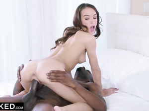 Petite brunette rides big black dick and enjoys interracial hardcore
