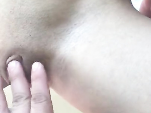 Dude is stroking shaved pussy and filming it on camera
